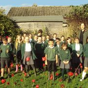 Spectra help local school create remembrance field of poppies