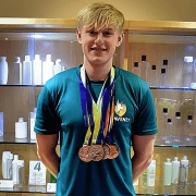 Spectra helps local swimmer aim for gold in Tokyo